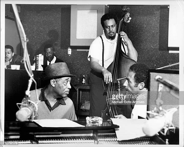 Composer Duke Ellington and bass player Charles Mingus during the recording of their album 'Money Jungle' which was released in 1962