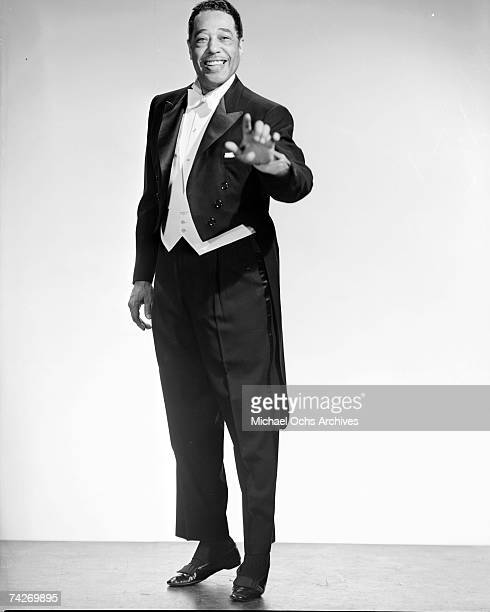 Composer Duke Ellington poses for portrait session wearing a tuxedo with coattails in circa 1958.