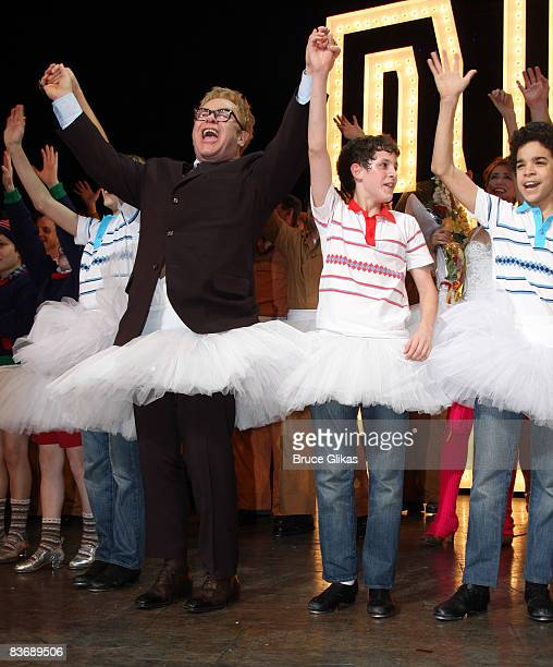 Composer Elton John appears on stage with alternate lead role actors Kiril Kulish Trent Kowalik and David Alvarez during the opening night curtain...
