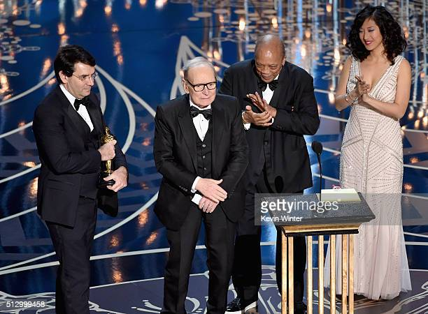 Composer Ennio Morricone accepts the Best Original Score award for ''The Hateful Eight' from musician Quincy Jones onstage during the 88th Annual...