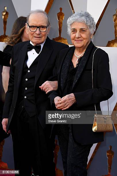 Composer Ennio Morricone and his wife Maria Travia attend the 88th Annual Academy Awards at Hollywood Highland Center on February 28 2016 in...