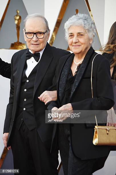 Composer Ennio Morricone and Maria Travia attend the 88th Annual Academy Awards at Hollywood Highland Center on February 28 2016 in Hollywood...