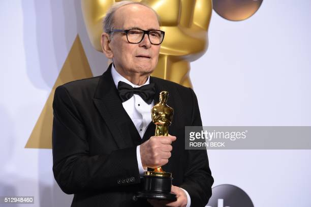 Composer Ennio Morricone poses with the Oscar for Best Original Score The Hateful Eight in the press room during the 88th Oscars in Hollywood on...