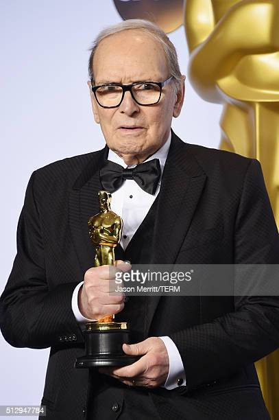 Composer Ennio Morricone winner of the Best Original Score award for ''The Hateful Eight' poses in the press room during the 88th Annual Academy...