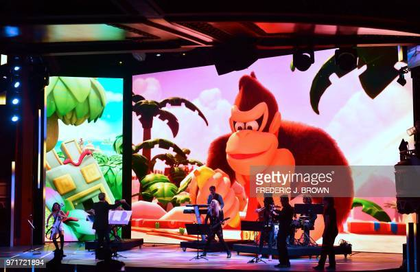 Composer Grant Kirkhope leads the orchestra during an introduction to new games at the Ubisoft E3 2018 media briefing inside the Orpheum Theatre in...