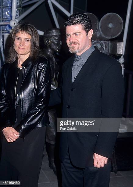 Composer Gustavo Santaolalla and wife Alejandra Palacios attend the 'Amores Perros' Hollywood Premiere on March 27 2001 at GCC Galaxy 6 Theatres in...
