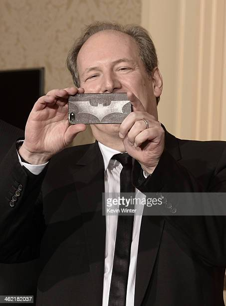 Composer Hans Zimmer takes a photo in the press room during the 71st Annual Golden Globe Awards held at The Beverly Hilton Hotel on January 12 2014...