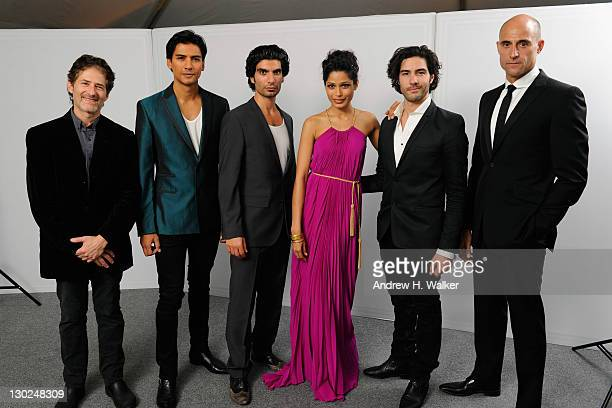 Composer James Horner actors Jan Uddin Akin Gazi Freida Pinto Tahar Rahim and Mark Strong pose for a portrait in the portrait studio at Katara...