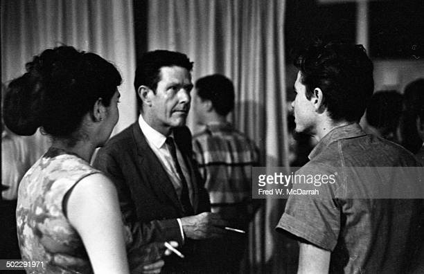 Composer John Cage talks with unidentified others at the 'Concert Of Dance' production at Judson Church New York New York July 6 1962