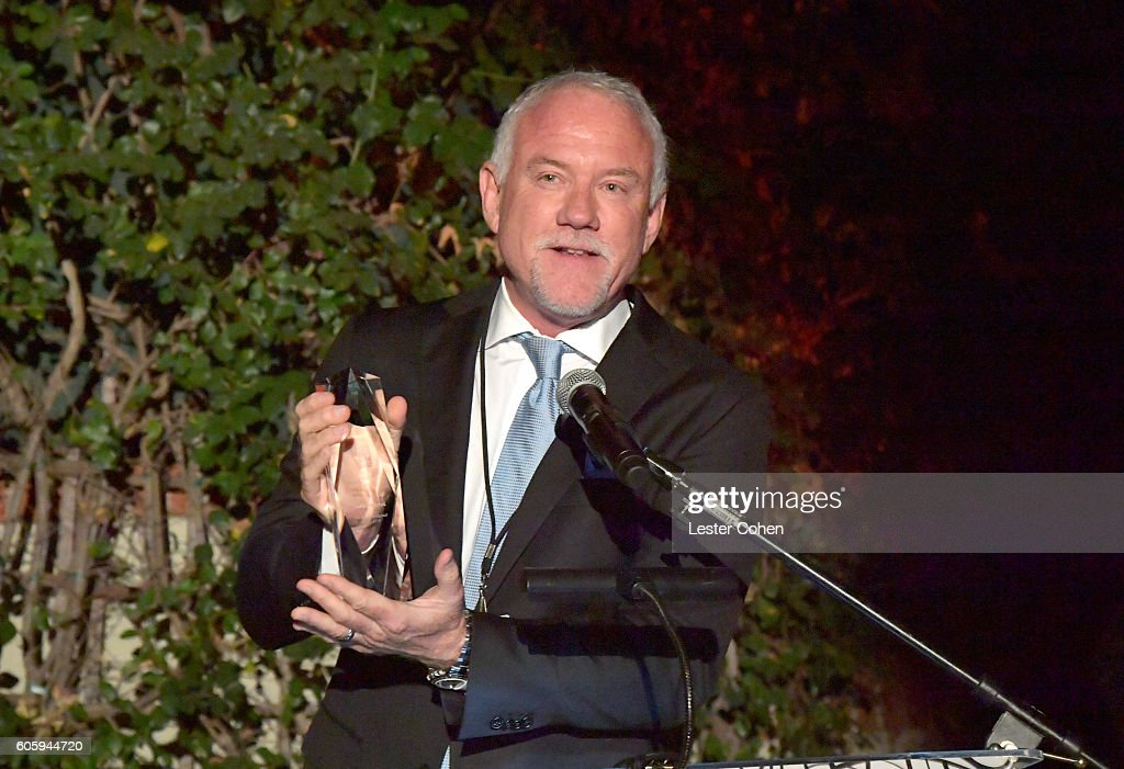 Composer John Debney accepts the 2016 Electronic Arts Composer Award during Songs Of Hope at a private residence on September 15, 2016 in Brentwood, California.