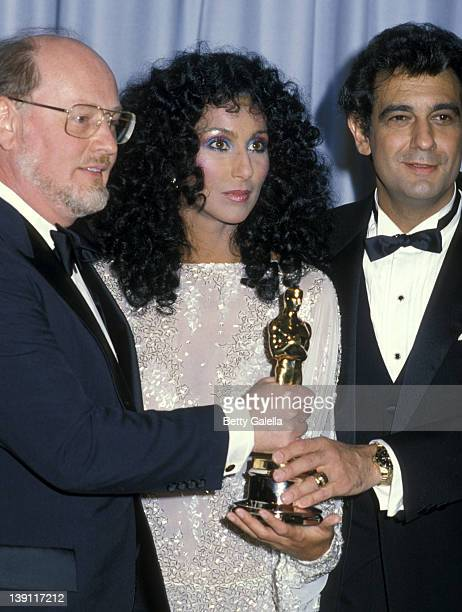 Composer John Williams singer/actress Cher singer Placido Domingo attend the 55th Annual Academy Awards on April 11 1983 at Dorothy Chandler Pavilion...