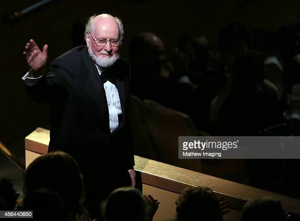 Composer John Williams waves to the audience at Los Angeles Philharmonic's Walt Disney Concert Hall Opening Night Gala on September 30 2014 in Los...