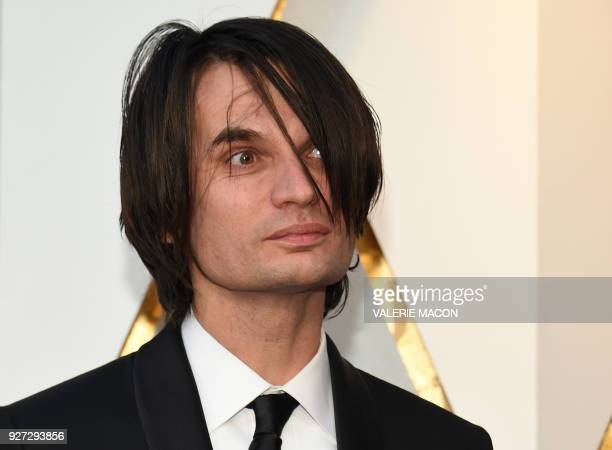 Composer Jonny Greenwood arrives for the 90th Annual Academy Awards on March 4 in Hollywood California / AFP PHOTO / VALERIE MACON