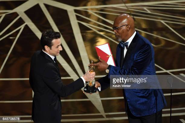 Composer Justin Hurwitz accepts Best Original Score for 'La La Land' from actor Samuel L Jackson onstage during the 89th Annual Academy Awards at...