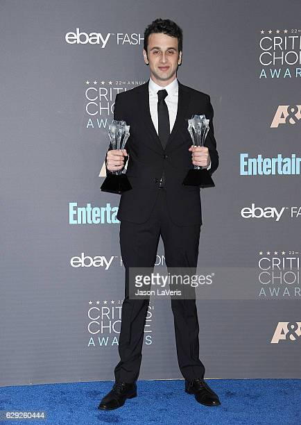 Composer Justin Hurwitz poses in the press room at the 22nd annual Critics' Choice Awards at Barker Hangar on December 11 2016 in Santa Monica...