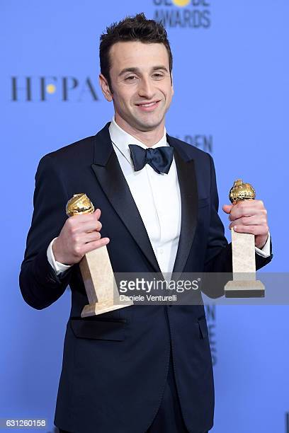 Composer Justin Hurwitz winner of Best Original Score and Best Original Song for 'La La Land' poses in the press room during the 74th Annual Golden...
