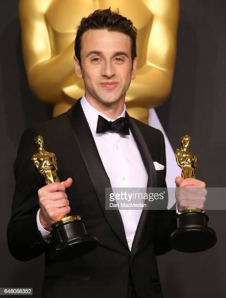 Composer Justin Hurwitz winner of Best Original Score and Best Original Song for 'La La Land' poses in the press room at the 89th Annual Academy...