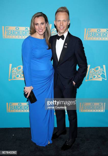 Composer Justin Paul and guest attend the Fox Searchlight And 20th Century Fox Oscars PostParty on March 4 2018 in Los Angeles California