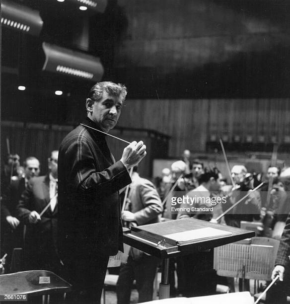 Composer Leonard Bernstein conducting at London's Royal Festival Hall