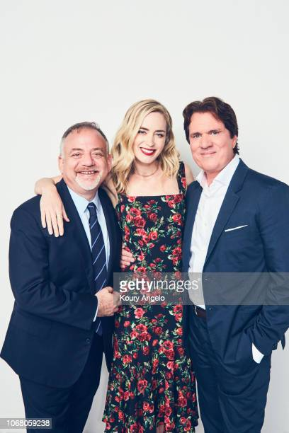 Composer Marc Shaiman actress Emily Blunt and director Rob Marshall are photographed for People Magazine on July 15 2017 at D23 Expo in Los Angeles...