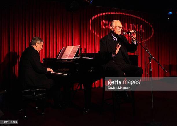Composer Marvin Hamlisch and lyricist Alan Bergman perform on stage at ASCAP's reception honoring Hamlisch Bergman and his wife Marilyn Bergman at...