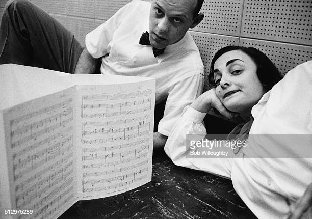 Composer Moose Charlap and lyricist Carolyn Leigh during a break in their work on the music and lyrics for the Broadway musical version of 'Peter...