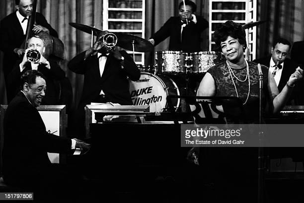 Composer musician and bandleader Duke Ellington at piano and jazz singer Ella Fitzgerald perform with the Duke Ellington Orchestra at NBCTV Studios...