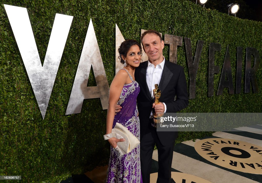 Composer Mychael Danna (R) and Aparna Danna arrive for the 2013 Vanity Fair Oscar Party hosted by Graydon Carter at Sunset Tower on February 24, 2013 in West Hollywood, California.