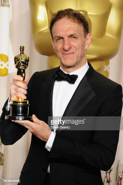 Composer Mychael Danna poses in the press room during the Oscars at the Loews Hollywood Hotel on February 24, 2013 in Hollywood, California.