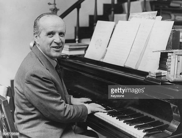 Composer Nino Rota who wrote the theme for the film 'The Godfather' pictured at the piano circa 1972