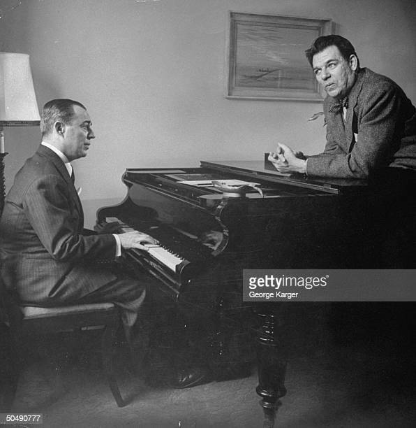 Composer Oscar Hammerstein II collaborating with composer Richard Rodgers at the piano
