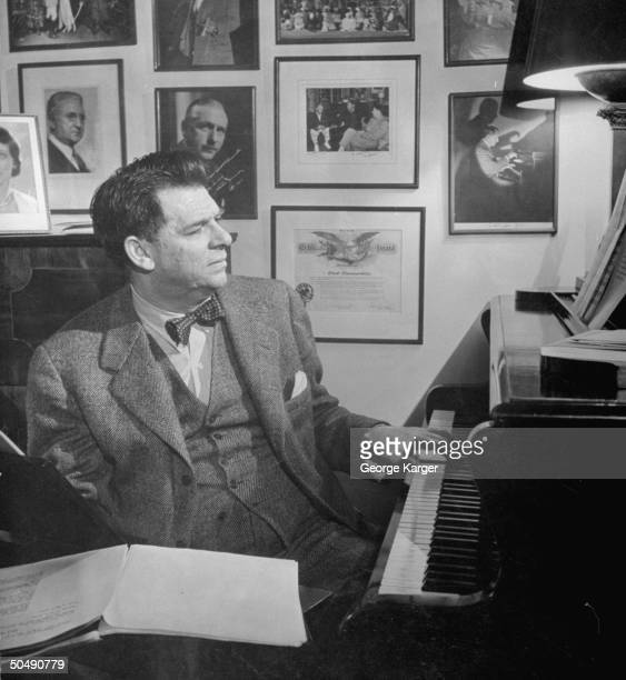 Composer Oscar Hammerstein II posing for a picture at his home