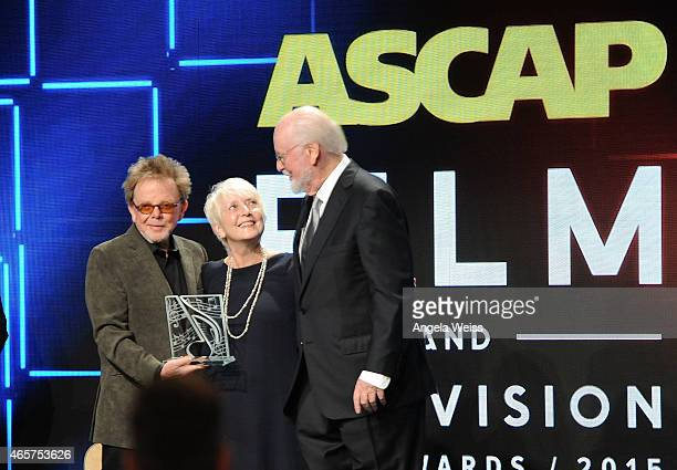 Composer Paul Williams and Alf Clausen honor special consultant Nancy Knutsen on stage at the 30th Annual ASCAP Film Television Music Awards at The...