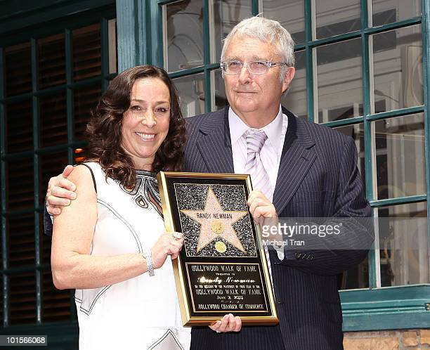 Composer Randy Newman and his wife Gretchen Preece attend the Hollywood Walk Of Fame star ceremony honoring him on June 2 2010 in Hollywood California