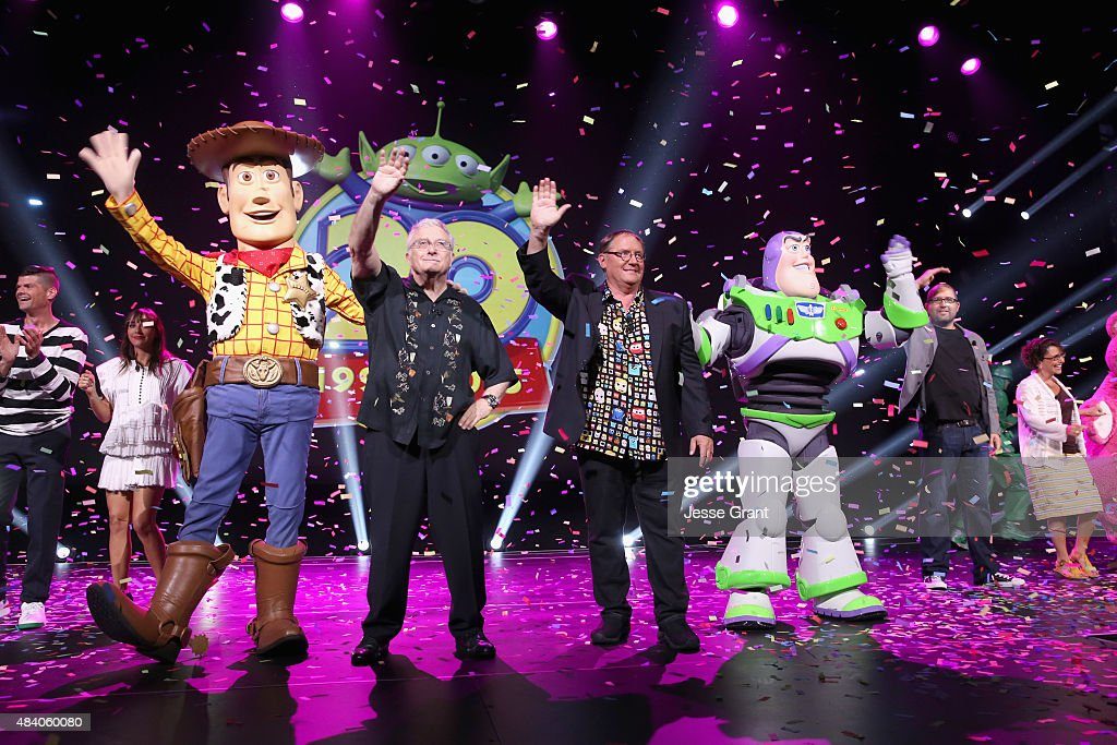 Composer Randy Newman of TOY STORY 1, 2 and 3 and director John Lasseter of TOY STORY 4 (C) took part today in 'Pixar and Walt Disney Animation Studios: The Upcoming Films' presentation at Disney's D23 EXPO 2015 in Anaheim, Calif.