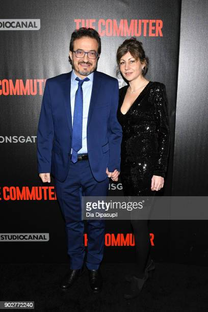 Composer Roque Banos and guest attend 'The Commuter' New York premiere at AMC Loews Lincoln Square on January 8 2018 in New York City