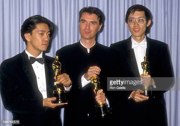 Composer Ryuichi Sakamoto musician David Byrne of Talking Heads and composer Cong Su attend the 60th Annual Academy Awards on April 11 1988 at Shrine...