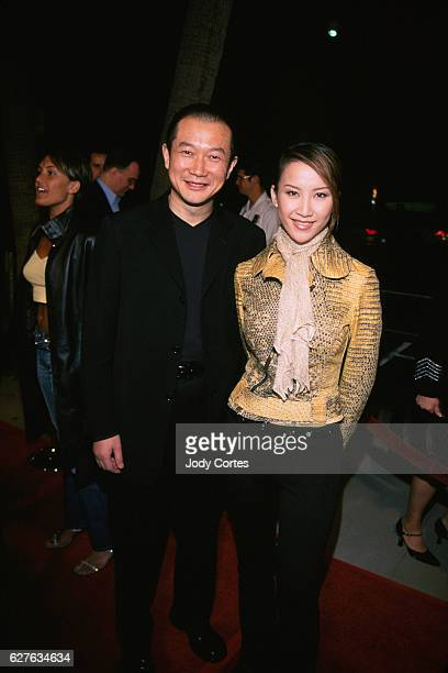 Composer Tan Dun and singer Coco Lee arrive at the Crouching Tiger Hidden Dragon premiere