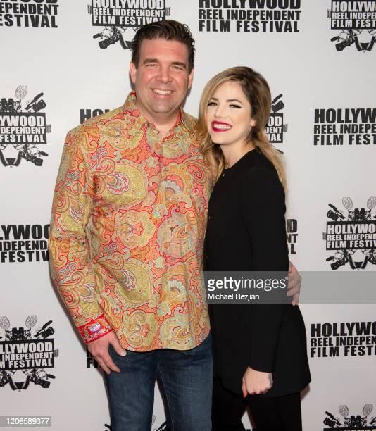 Composer Tim Jones and Maria Gabriela Cardenas arrive at A Dark Foe Film Premiere on February 15 2020 in Los Angeles California