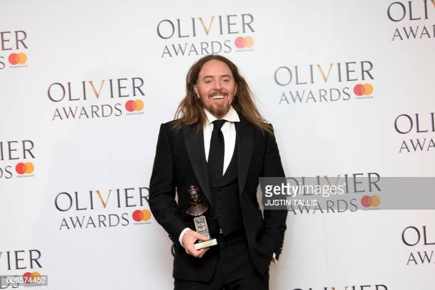 Composer Tim Minchin winner of the Best New Musical for the play Groundhog Day poses with his award during the 2017 Laurence Olivier Awards in London...