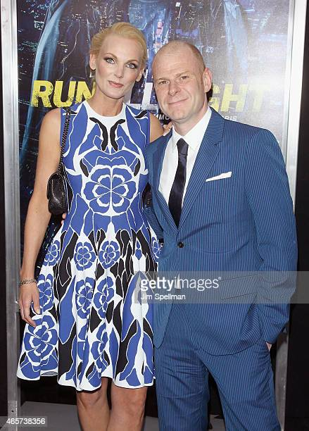 Composer Tom Holkenborg and wife attend the Run All Night New York premiere at AMC Lincoln Square Theater on March 9 2015 in New York City