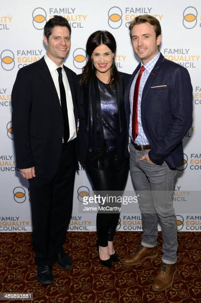 Composer Tom Kitt actors Idina Menzel and James Snyder attend the Family Equality Council's 2014 Night at the Pier at Pier 60 on May 12 2014 in New...