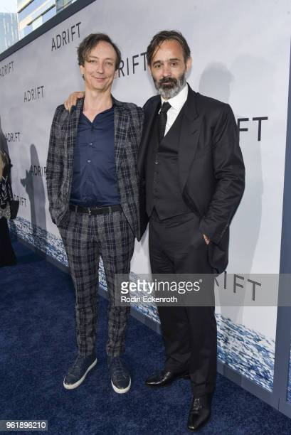 Composer Volker Bertelmann and Baltasar Kormakur arrive at the premiere of STX Films' 'Adrift' at Regal LA Live Stadium 14 on May 23 2018 in Los...