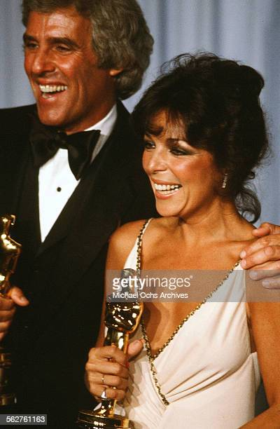 Composers Carole Bayer Sager and Burt Bacharach poses backstage after winning Best Original Song during the 54th Academy Awards at Dorothy Chandler...
