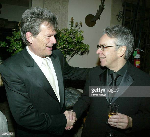 Composers David Foster and Howard Shore arrive at the Warner Music Group's PostGrammy party at Katana on February 8 2004 in West Hollywood California