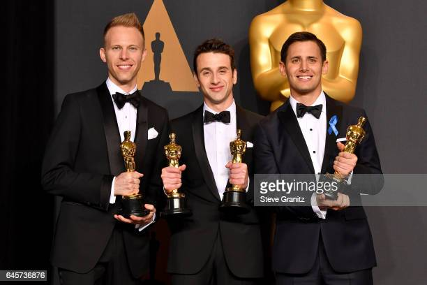 Composers Justin Paul Justin Hurwitz and Benj Pasek winners of the award for Music for 'City of Stars' from 'La La Land' poses in the press room...
