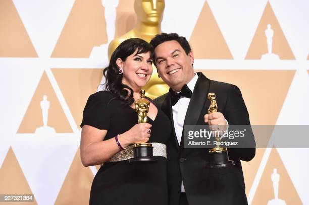 Composers Kristen AndersonLopez and Robert Lopez winners of the Best Original Song award for 'Remember Me' from 'Coco' pose in the press room during...