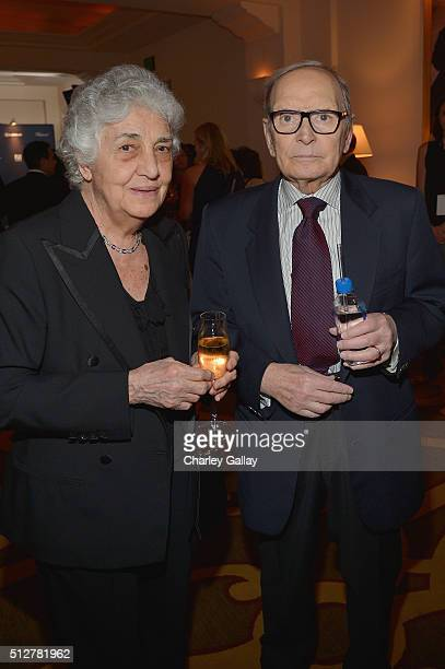 Composers Maria Travia and Ennio Morricone attend The Weinstein Company's PreOscar Dinner presented in partnership with FIJI Water Chopard DeLeon and...