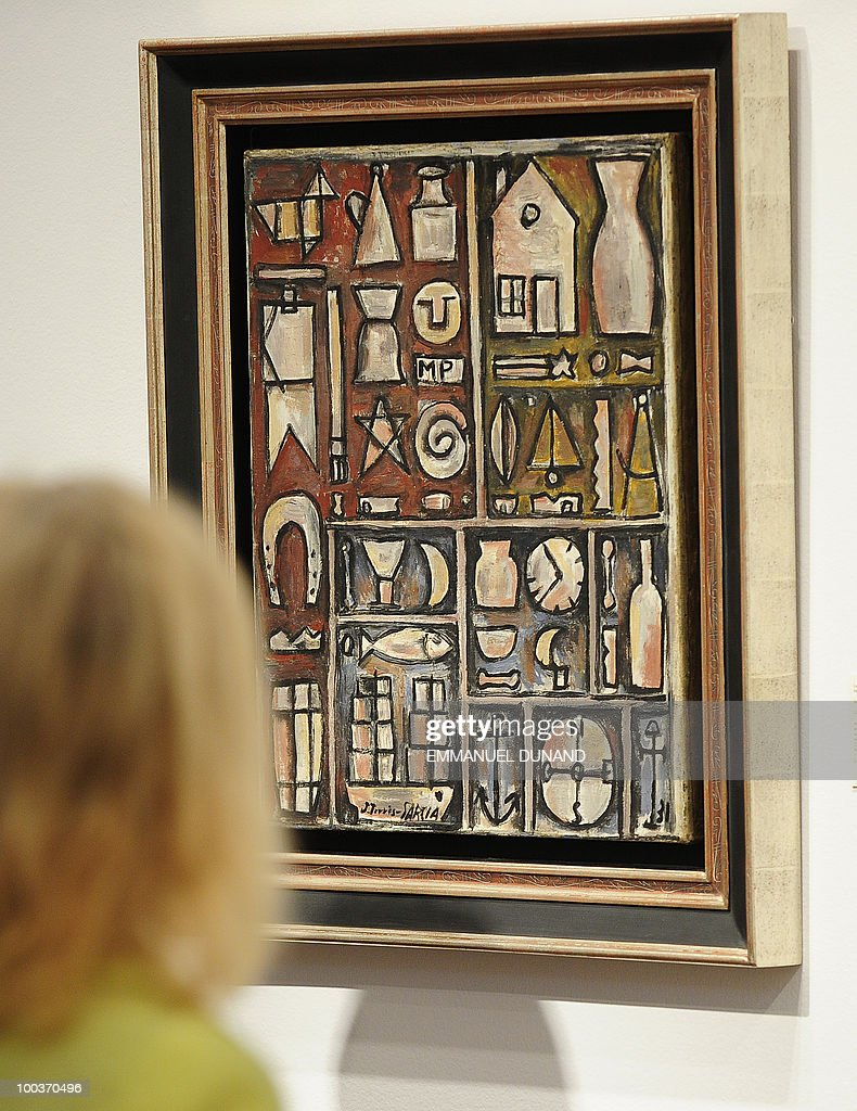 'Composicion Constructiva en Planos y Figuras' by Joaquin Torres-Garcia is on display during a preview of Christie's Latin American Art auctions, May 24, 2010 in New York. Christie's will hold its Latin American Art auctions on May 26 and 27, 2010. AFP PHOTO/Emmanuel Dunand