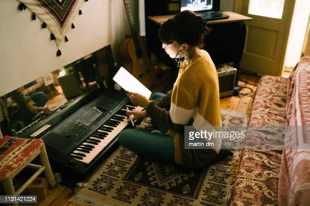 composing new music - keyboard player stock photos and pictures